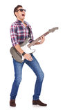 Screaming guitarist playing. Guitarist playing his electric guitar and screaming  on white background Stock Photography