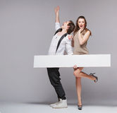 Screaming guy in funny pose with his girlfriend Royalty Free Stock Photography