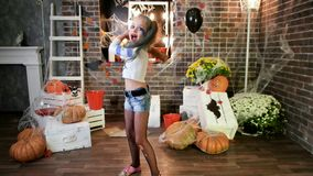 Screaming harley quinn threatens with baseball bat, girl play crazy character, halloween party. Screaming harley quinn threatens with baseball bat, little girl stock video