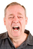 Screaming for Help. A middle aged man is screaming for help Stock Image