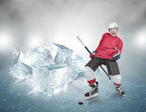 Screaming hockey player on abstract ice background Royalty Free Stock Photos