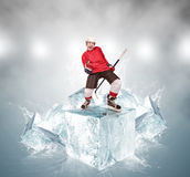 Screaming hockey player on abstract ice cubes background Royalty Free Stock Photos