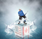 Screaming hockey player on abstract ice cubes background Stock Photo