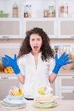 Screaming housewife drying a lot of dishes Stock Photos