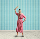 Screaming housewife with rolling pin Stock Photos