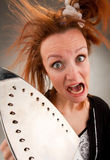 Screaming housewife with steam iron Stock Photography