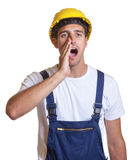 Screaming latin construction worker Royalty Free Stock Photos