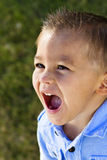 Screaming Little Boy. A cute little hispanic boy screaming. Selective focus on the face Royalty Free Stock Image