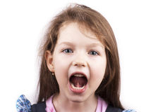Screaming little girl isolated, close up Stock Photos