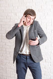 Screaming mad man with several phones Stock Photos