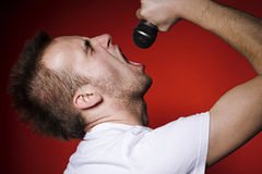 Screaming man. Young man screaming to the microphone Royalty Free Stock Photos