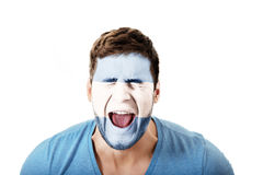 Screaming man with Argentina flag on face. Screaming man with Argentina flag painted on face stock image