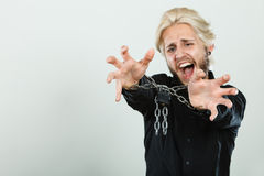 Screaming man with chained hands, no freedom Royalty Free Stock Photos