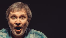 The screaming man in denim shirt Stock Image