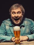 The screaming man in denim shirt with glass of Royalty Free Stock Images