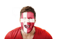 Screaming man with Denmark flag on face. Screaming man with Denmark flag painted on face Stock Photography