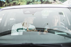 Screaming man and driving woman in a car. Screaming men and driving women in a car. Woman driver Stock Images