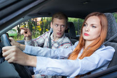 Screaming man and driving woman. Screaming men and driving women in a car Royalty Free Stock Images