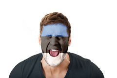 Screaming man with Estonia flag on face. Royalty Free Stock Photos