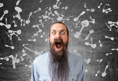 Screaming man and falling keys, blackboard. Close up of a screaming man with a long beard standing near a blackboard with key sketches drawn on it. 3d rendering Stock Images