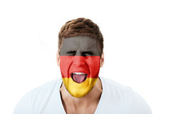 Screaming man with Germany flag on face. Stock Photos