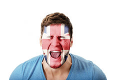 Screaming man with Great Britain flag on face. Screaming man with Great Britain flag painted on face Royalty Free Stock Image