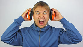 Screaming man with headphones Stock Image