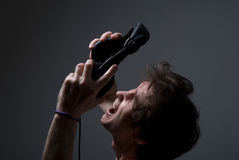 Screaming man with headphones. A fan of rock Royalty Free Stock Images