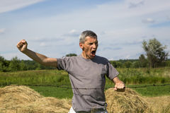 Screaming man holding a barbed wire.  Royalty Free Stock Image