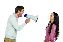 Screaming man holding loudspeaker with girlfriend Stock Photography