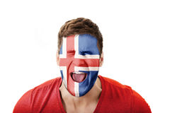 Screaming man with Iceland flag on face. Stock Image