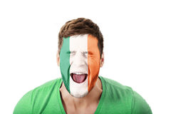 Screaming man with Ireland flag on face. Stock Photo