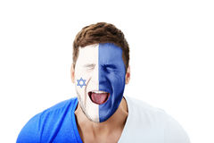Screaming man with Israel flag on face. Screaming man with Israel flag painted on face royalty free stock photography