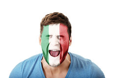 Screaming man with Italy flag on face. Stock Photos