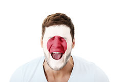 Screaming man with Japan flag on face. Stock Photo