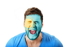 Screaming man with Kazakhstan flag on face. Stock Photo