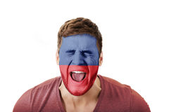Screaming man with Lichtenstein flag on face. Stock Photos