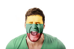 Screaming man with Lithuania flag on face. Royalty Free Stock Image