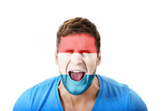Screaming man with Luksemburg flag on face. Royalty Free Stock Image