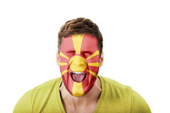 Screaming man with Macedonia flag on face. Stock Photo