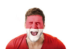 Screaming man with Monako flag on face. Stock Photography