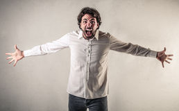 Screaming man with opened arms Stock Photo
