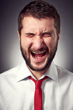 Screaming man over grey background Stock Image