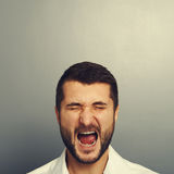 Screaming man over grey Royalty Free Stock Photos