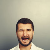 Screaming man over grey background Stock Photography
