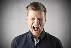 Screaming. A man is screaming for the pain Royalty Free Stock Photos