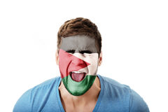 Screaming man with Palestine flag on face. Stock Images