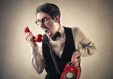 Screaming man at the phone stock photos