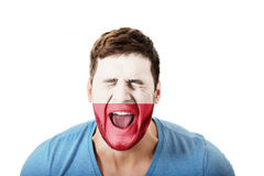 Screaming man with Poland flag on face. Royalty Free Stock Image