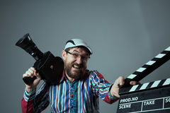 Screaming man retro movie camera and clapperboard Royalty Free Stock Image